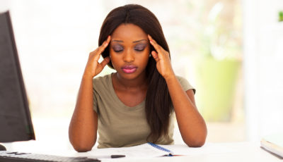 young female african american college student having headache